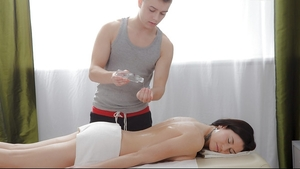 Masseur stretches brunette's asshole with hard fuck tool after cunnilingus