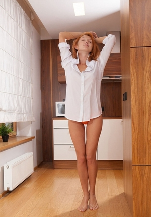 Red-haired gal takes off orange panties and white shirt to jerk off