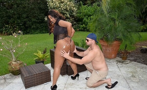 Whalelike dark-skinned Latina lets white dude oil enormous ass and play with titties