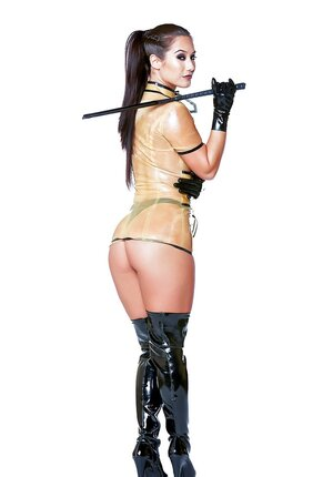 Dangerous vixen Eva Lovia in latex outfit, panties, high boots and besides with a whip