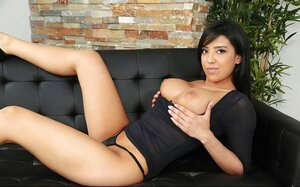 Black-haired Latina goddess takes off dress to show her terrific curves