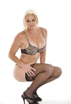 Aroused diva takes leopard lingerie off to open her big tits and additionally snatch