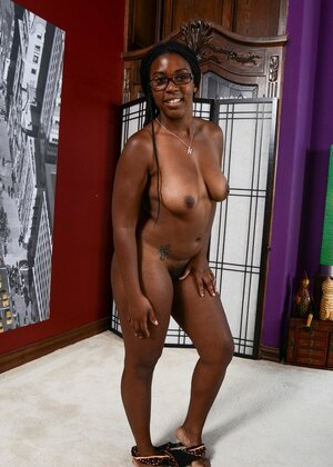 Black chick with large buttocks smiles so modestly taking various XXX poses