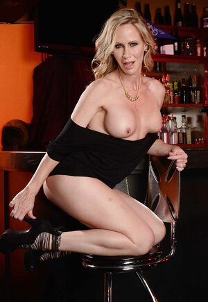 Eye-catching blonde Eager mom becomes aroused and furthermore climbs on bar top being undressed